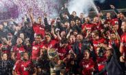 Crusaders celebrate after their second consecutive Super Rugby title win.  By Marty MELVILLE (AFP)
