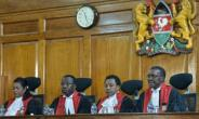 David Maraga (R), the chief justice of Kenya's Supreme Court, is guided by two things: his absolute faith in God and in the law.  By SIMON MAINA (AFP/File)