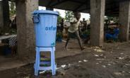 Dispensers containing water mixed with disinfectant are being used in Mbandaka during the Ebola outbreak.  By Junior D. KANNAH (AFP)