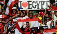Egyptian fans cheer for their national team before the FIFA World Cup 2018 qualification football match against Uganda at the Borg al-Arab Stadium near Alexandria September 5, 2017.  By KHALED DESOUKI (AFP)