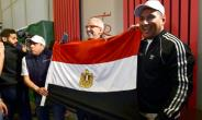 Egyptian representatives celebrate in Dakar after the Confederation of African Football (CAF) executive committee's decision to choose Egypt to host the 2019 Africa Cup of Nations.  By SEYLLOU (AFP)