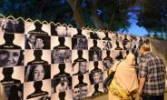 Egyptians look at posters of the 66 victims of the EgyptAir MS804 flight that crashed in the Mediterranean Sea, in Cairo on May 26, 2016.  By KHALED DESOUKI, KHALED DESOUKI (AFP/File)
