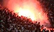Egypt's Zamalek fans fire flares during the football match between Egypt's Zamalek and Al Ahli Tripoli during their African Champions League (CAF) group stage football match, at Borg el-Arab Stadium near Alexandria on July 9, 2017.  By KHALED DESOUKI (AFP/File)