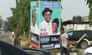 Election time: A campaign poster in Lagos for President Muhammadu Buhari and Vice President Yemi Osinbajo, contending next month's polls.  By PIUS UTOMI EKPEI (AFP)