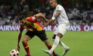 Esperance and Tunisia star Anice Badri (L) in action against Al Ain of the UAE during the 2018 Club World Cup. His stoppage-time goal salvaged a draw for the African club champions away to Horoya in Guinea Friday.  By Karim Sahib (AFP)