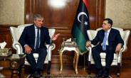 European Parliament President Antonio Tajani (L) meets with Libya's unity government Prime Minister Fayez al-Sarraj at his office in the capital Tripoli on July 9, 2018.  By STRINGER (AFP)