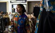 Fashion designer Mandisa Zwane is one of dozens of township entrepreneurs being helped by Soweto's Box Shop not for profit organisation.  By GULSHAN KHAN (AFP)
