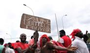 'Faure step down': protesters have been flocking to join a series of massive street protests in Togo which began in August and have shaken the government.  By Matteo Fraschini KOFFI (AFP/File)