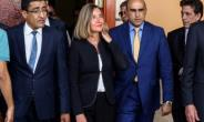 Federica Mogherini (C), the EU's High Representative for Foreign Affairs and Security Policy, at Mitiga International Airport, near Tripoli, on July 14, 2018.  By STRINGER (AFP)