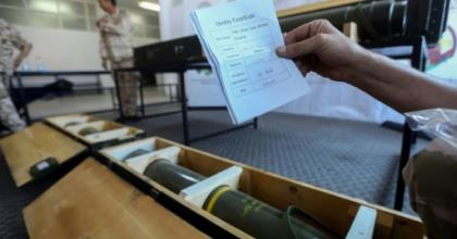 Fighters loyal to Libya's UN-recognised government display Chinese-made shells bearing the markings of the United Arab Emirates, reportedly seized from Haftar's forces, in June 2019.  By - (AFP)