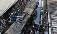 Firefighters and onlookers at the scene of a  train crash in Cairo's main rail station last month.  By STRINGER (AFP/File)