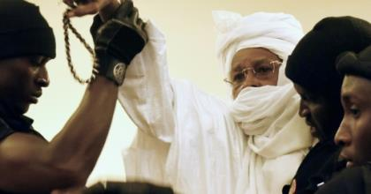 Former Chadian dictator Hissene Habre (C, pictured being escorted to court in 2015) has been granted two months' leave from prison as his jail is being used for new detainees in coronavirus quarantine.  By SEYLLOU (AFP/File)