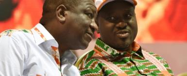 Former Ivorian rebel chief Guillaume Soro, seen here on the right, has said he is stepping down as parliamentary leader.  By SIA KAMBOU (AFP/File)