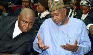 Former national security adviser of ex-president Goodluck Jonathan, Sambo Dasuki (right), speaks with his lawyer Ahmed Raji, during his trial at the federal high court in Abuja, on September 1, 2015.  By STRINGER (AFP/File)