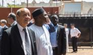 French Foreign Affairs Minister Jean-Yves Le Drian, left, with Burkina Faso's Foreign Affairs Minister Alpha Barry at the inauguration of an education and start-up incubator in Ouagadougou on October 19, 2018.  By OLYMPIA DE MAISMONT (AFP)