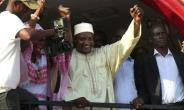 Gambia's President-elect Adama Barrow gestures to the crowd following his victory in the polls in Kololi on December 2, 2016.  By Joe Sinclair (AFP)