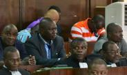 General Brunot Dogbo Ble, seen wearing a blue shirt, was sentenced to 18 years.  By ISSOUF SANOGO (AFP/File)