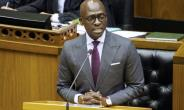Gigaba, seen here delivering the 2018 budget speech in February, when he was finance minister.  By RODGER BOSCH (AFP)