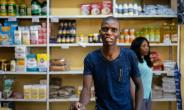 Grocery store owner Blessing Mushonga in his shop in Rimuka township, Kadoma. Life is getting harder for many Zimbabweans as the economic crisis worsens -- daily necessities are often in short supply.  By ZINYANGE AUNTONY (AFP/File)