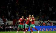 Hakim Ziyech scored twice for Morocco against Cameroon and their qualification for the African Cup of Nations was confirmed when Malawi slipped away to Comoros.  By FADEL SENNA (AFP)