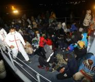 Hundreds of migrants faced being trapped at sea for days because of stormy conditions.  By MAHMUD TURKIA (AFP)