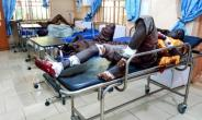 Injured men in hospital after a suicide bomber attack in northeastern Nigeria last month, with another 31 killed late Saturday in a similar attack suspected to be the work of Boko Haram jihadists..  By AUDU MARTE (AFP)