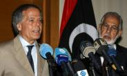 Italian Foreign Minister Enzo Moavero Milanesi (L) speaks during a press conference with his Libyan government counterpart Mohamad Siala in the capital Tripoli on July 7, 2018.  By Mahmud TURKIA (AFP)