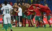 Ivory Coast players watch as Moroccan players celebrate at the end of their 2017 Africa Cup of Nations match on January 24, 2017.  By ISSOUF SANOGO (AFP)