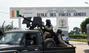 Ivory Coast's main port of Abidjan, one of Africa's biggest, was shut down when angry security forces began firing into the air amid protests by mutinous troops.  By Sia Kambou (AFP)