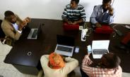 Journalists attend a meeting with Adil al-Baz (L), editor of online newspaper Al-Ahdath News, at his office in downtown Khartoum.  By ASHRAF SHAZLY (AFP)