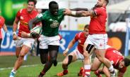 Kenya centre Collins Injera is tackled during the defeat to Canada in the World Cup qualifying tournament.  By GERARD JULIEN (AFP)