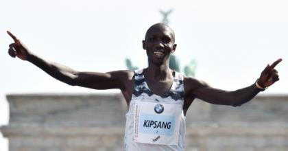 Kipsang, seen here at the Berlin Marathon in 2018, spent the night in jail for breaking Kenya's curfew.  By John MACDOUGALL (AFP)