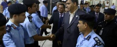 Libyan Interior Minister Abdessalam Ashour (C-R) and undersecretary of the Ministry of Communications in the Al-Wefaq Government Hisham Abu Shkiwat (C-L) greet members of the security forces for Tripoli's Mitiga International Airport.  By MAHMUD TURKIA (AFP)