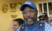 Liberian presidential candidate and ex-football star George Weah is idolised in his country as 'Mister George'.  By SEYLLOU (AFP/File)