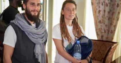 Luca Tacchetto and Edith Blais appeared slightly disoriented when they landed in Bamako.  By MICHELE CATTANI (AFP)