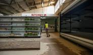 Many shops have been sporting empty shelves.  By Jekesai NJIKIZANA (AFP/File)