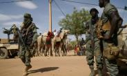 Malian soldiers on patrol in the city of Menaka, Mali in May 2018.  By Sebastien RIEUSSEC (AFP/File)