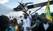Martin Fayulu (C), who is vying to replace President Joseph Kabila in the pivotal December 23 polls, was greeted by thousands at a small airport near the restive eastern city of Beni in North Kivu.  By ALEXIS HUGUET (AFP)