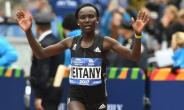 Mary Keitany of Kenya celebrates after taking second place in the Women's  Division during the 2017 TCS New York City Marathon in New York on November 5, 2017.  By TIMOTHY A. CLARY (AFP/File)