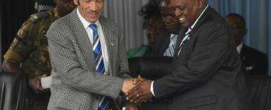 Masisi, right, took power in April when Khama, left, stepped aside after serving the maximum 10 years in office.  By MONIRUL BHUIYAN (AFP/File)