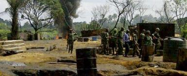Members of the Joint Military Task Force search illegal oil refineries at Mbiama community in Nigeria's Bayelsa State on March 6, 2011.  By STR (AFP/File)