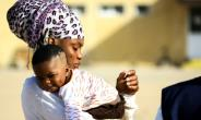 Migrants of different African nationalities arrive at a naval base in the capital Tripoli.  By MAHMUD TURKIA (AFP)