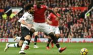Mohamed Salah (L) vies with Eric Bailly during Liverpool's defeat against Manchester United at Old Trafford.  By Oli SCARFF (AFP/File)