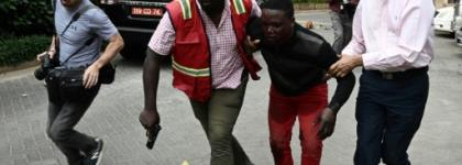 Nairobi attack: An injured man is evacuated from the Dusit2 hotel and office complex.  By SIMON MAINA (AFP)