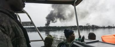 Nigerian Navy forces on the lookout for illegal oil refineries in the Niger Delta region spot the tell-tale signs of billowing black smoke.  By STEFAN HEUNIS (AFP)