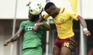 Nigeria's Victor Moses (L) heads the ball with Cameroon's Ngoran Fai during their match at Godswill Akpabio International Stadium in Uyo, southern Nigeria, on September 1.  By PIUS UTOMI EKPEI (AFP)