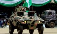 Nigeria's army, seen here parading vehicles, confirmed eight troops had been killed in a militant attack over the weekend.  By Sodiq ADELAKUN (AFP)