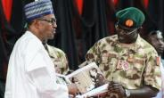 Nigeria's President Muhammadu Buhari, seen here with the army chief of staff this week, is under pressure to show results in the fight against Boko Haram ahead of February elections.  By Audu MARTE (AFP/File)