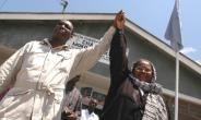 Opposition Chadema's (Party of Democracy and Progress) chairman Freeman Mbowe (L), pictured 2005, was arrested at Kisutu court alongside fellow opposition MP Esther Matiko.  By MWANZO MILLINGA (AFP/File)