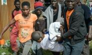 People carry the body of a man allegedly shot dead by police in Friday's clashes.  By SIMON MAINA (AFP)